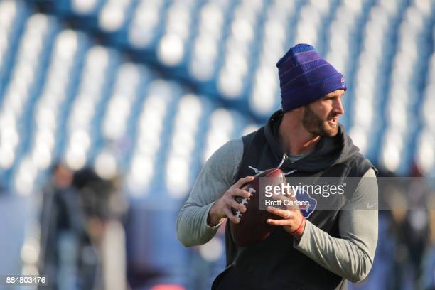 Nathan Peterman of the Buffalo Bills holds the ball while warming up before a game against the New England Patriots on December 3 2017 at New Era...