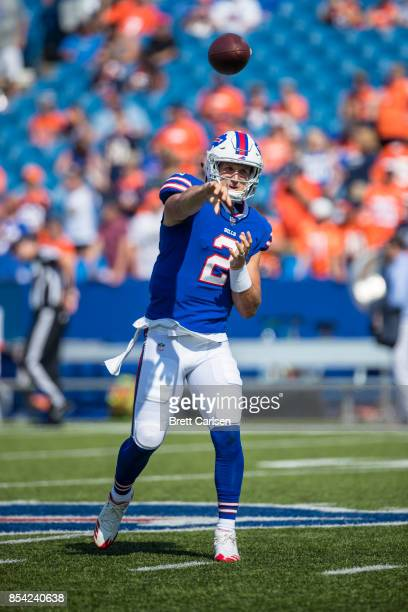 Nathan Peterman of the Buffalo Bills passes the ball to warm up before the game against the Denver Broncos on September 24 2017 at New Era Field in...