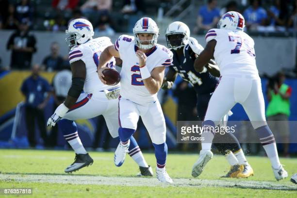 Nathan Peterman of the Buffalo Bills runs with the ball gain extra yardage during first quarter of the NFL game against the Los Angeles Chargers at...