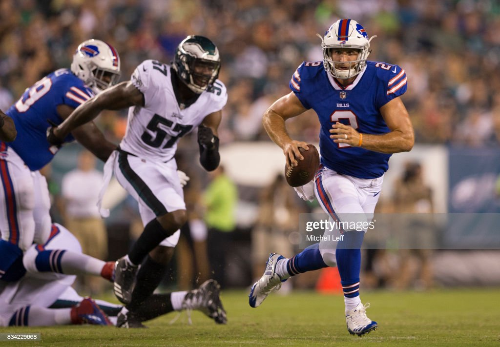 Nathan Peterman #2 of the Buffalo Bills runs with the ball with Alex McCalister #57 of the Philadelphia Eagles chasing after him in the third quarter of the preseason game at Lincoln Financial Field on August 17, 2017 in Philadelphia, Pennsylvania. The Eagles defeated the Bills 20-16.