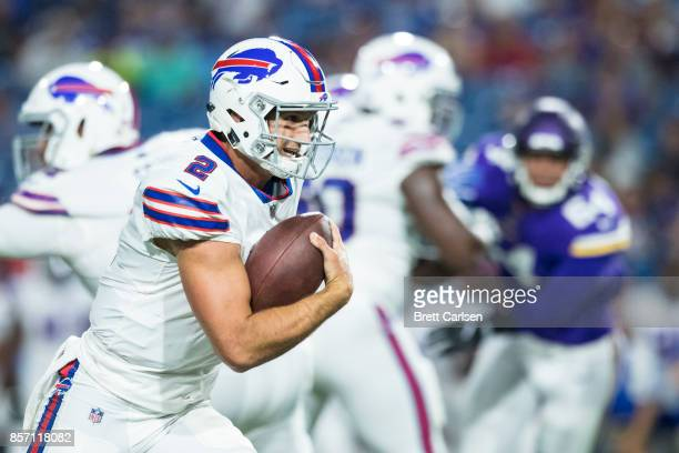 Nathan Peterman of the Buffalo Bills scrambles with the football during the second half against the Minnesota Vikings on August 10 2017 at New Era...