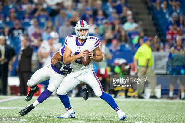 Nathan Peterman of the Buffalo Bills spins to attempt to avoid a sack by Eric Wilson of the Minnesota Vikings during the fourth quarter on August 10...