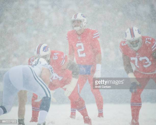 Nathan Peterman of the Buffalo Bills stands under center amidst heavy snowfall during the first quarter against the Indianapolis Colts at New Era...