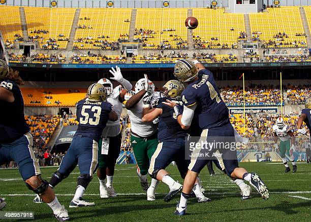 Nathan Peterman of the Pittsburgh Panthers drops back to pass in the first half during the game against the Miami Hurricanes on November 27 2015 at...