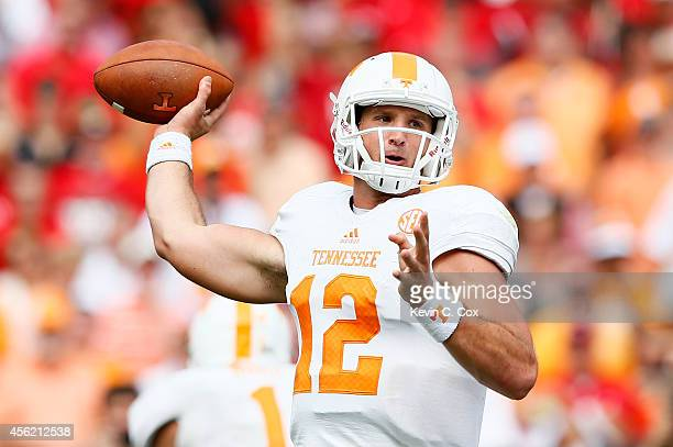 Nathan Peterman of the Tennessee Volunteers looks to pass against the Georgia Bulldogs at Sanford Stadium on September 27 2014 in Athens Georgia