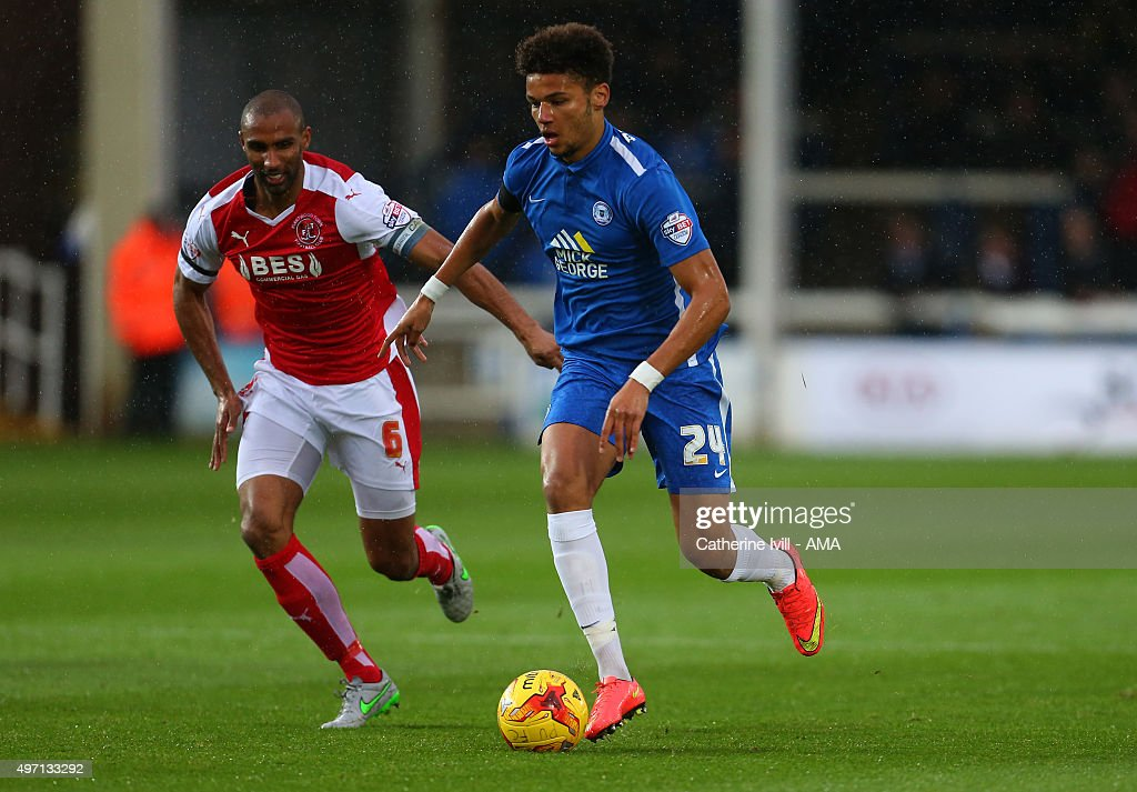 Nathan Pond of Fleetwood Town and Lee Angol of Peterborough United during the Sky Bet League One match between Peterborough United and Fleetwood Town at London Road Stadium on November 14, 2015 in Peterborough, England.