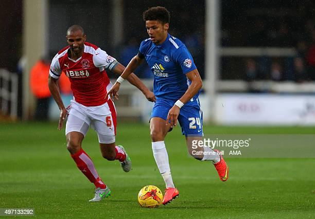 Nathan Pond of Fleetwood Town and Lee Angol of Peterborough United during the Sky Bet League One match between Peterborough United and Fleetwood Town...