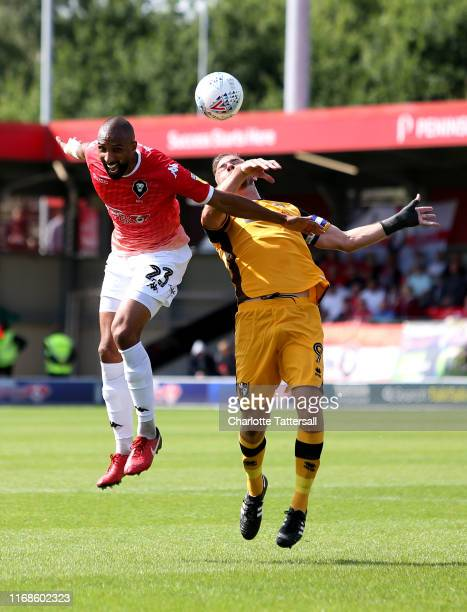 Nathan Pond of Salford City and Tom Pope of Port Vale compete for a header during the Sky Bet League Two match between Salford City and Port Vale at...