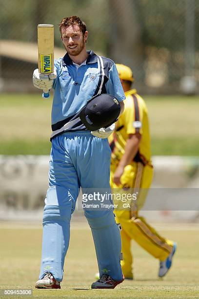 Nathan Price of New South Wales raises his bat after scoring 100 runs against Western Australia duringday 4 of the National Indigenous Cricket...