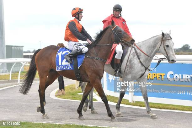 Nathan Punch returns to the mounting yard on Bonnard after winning the Thrifty BM58 Handicap at Racingcom Park Synthetic Racecourse on July 09 2017...
