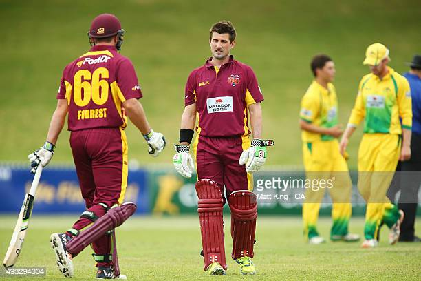 Nathan Reardon of the Bulls talks to Peter Forrest of the Bulls during the Matador BBQs One Day Cup match between Queensland and the Cricket...