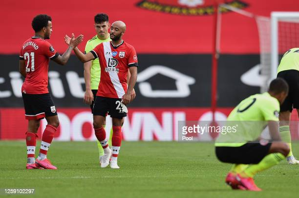 Nathan Redmond and Ryan Bertrand of Southampton celebrate at the final whistle following the Premier League match between Southampton FC and...