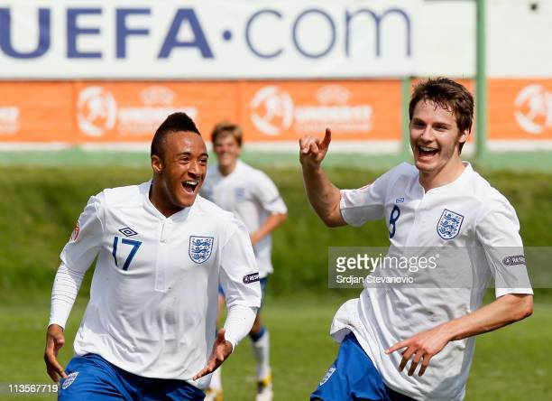 Nathan Redmond celebrates with goal scorer Nicholas Powell during their UEFA Under 17 Championship group A match between England and France at...
