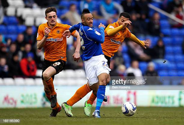 Nathan Redmond of Birmingham is challenged by David Davis of Wolves during the npower Championship match between Birmingham City and Wolverhampton...