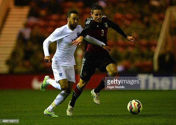Nathan Redmond of England and Christian Gunter of Germany tussle for the ball during the international friendly between England Under 21 and Germany...