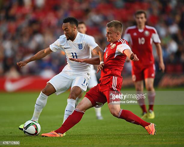 Nathan Redmond of England battles with Siarhei Karpovich of Belarus during the International Match between England U21 and Belarus U21 at Oakwell...