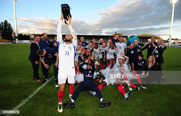 Nathan Redmond of England grabs a video camera and celebrates with the team during the Final of the Toulon Tournament between England and France at...