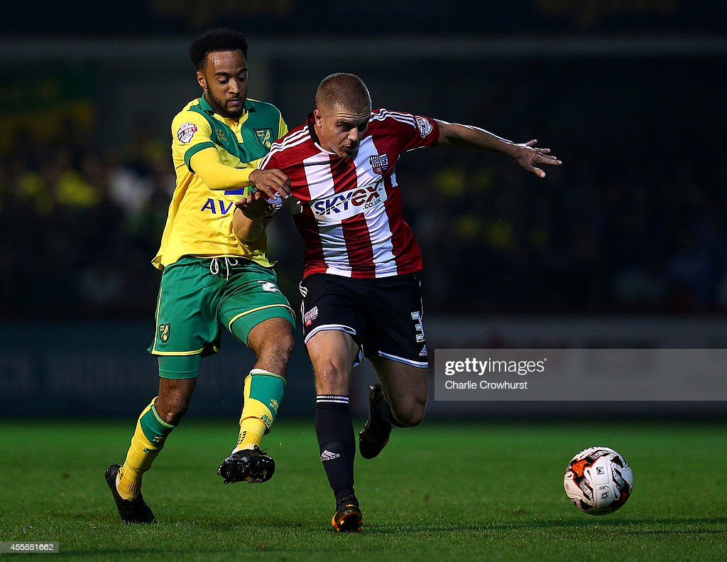 Nathan Redmond of Norwich battles with Brentford's Jake Bidwell for the ball during the Sky Bet Championship match between Brentford and Norwich City at Griffin Park on September 16, 2014 in Brentford, England.