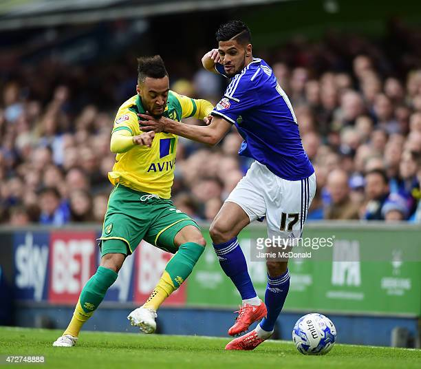 Nathan Redmond of Norwich challenges for the ball with Kevin Bru of Ipswich during the Sky Bet Championship Playoff semifinal first leg match between...