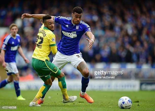 Nathan Redmond of Norwich challenges Tyrone Mings of Ipswich during the Sky Bet Championship Playoff semifinal first leg match between Ipswich Town...