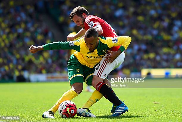 Nathan Redmond of Norwich City and Juan Mata of Manchester United compete for the ball during the Barclays Premier League match between Norwich City...