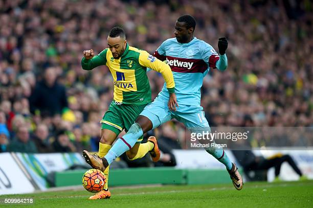 Nathan Redmond of Norwich City and Pedro Mba Obiang of West Ham United compete for the ball during the Barclays Premier League match between Norwich...