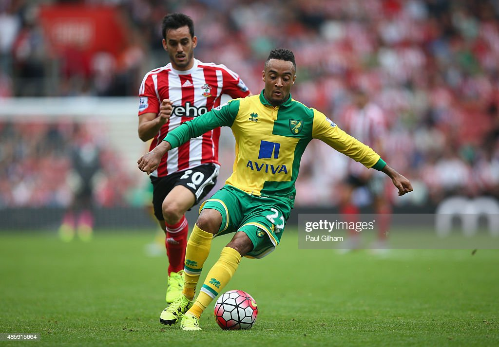 Nathan Redmond of Norwich City evades the challenge of Juanmi of Southampton during the Barclays Premier League match between Southampton and Norwich City on August 30, 2015 in Southampton, United Kingdom.