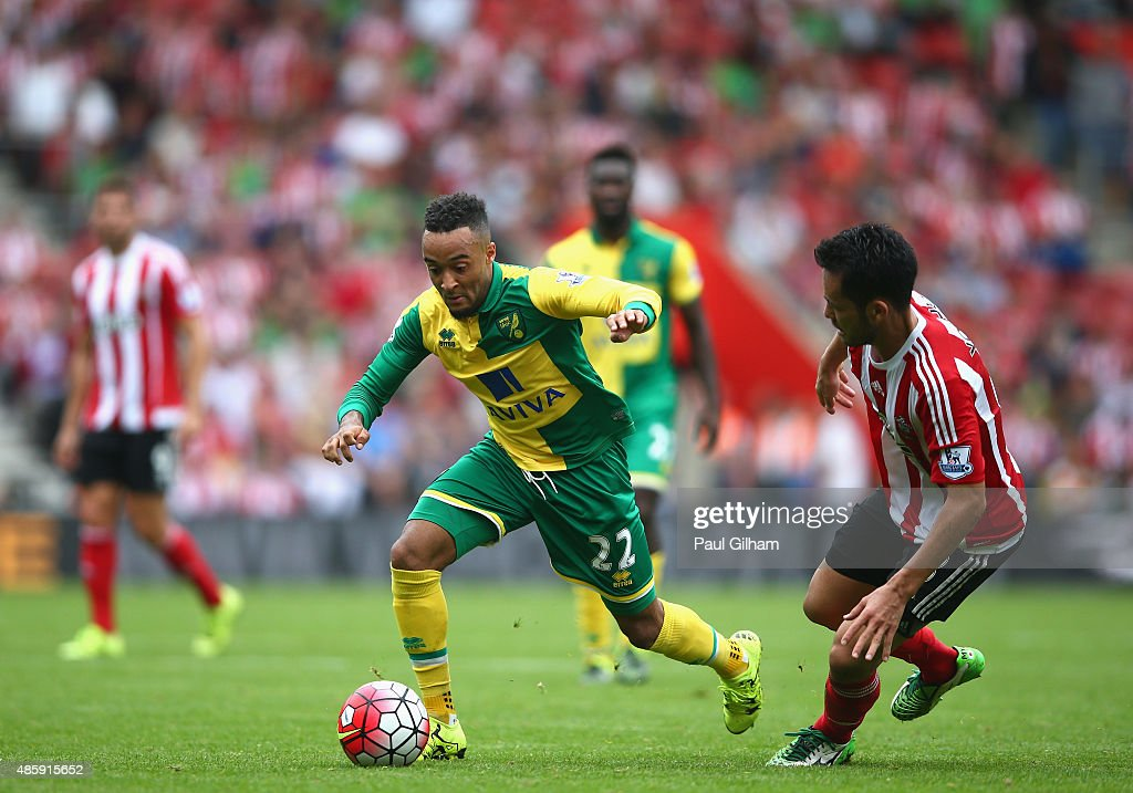 Nathan Redmond of Norwich City evades the challenge of Maya Yoshida of Southampton during the Barclays Premier League match between Southampton and Norwich City on August 30, 2015 in Southampton, United Kingdom.