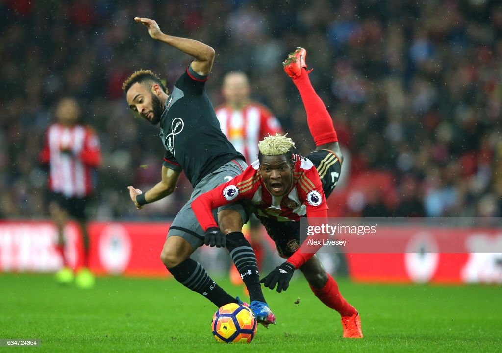 Nathan Redmond of Southampton and Dider N'dong of Sunderland compete for the ball during the Premier League match between Sunderland and Southampton at Stadium of Light on February 11, 2017 in Sunderland, England.