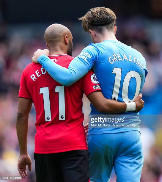 Nathan Redmond of Southampton and Jack Grealish of Manchester City speak during the Premier League match between Manchester City and Southampton at...
