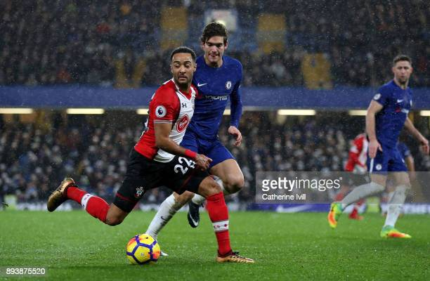 Nathan Redmond of Southampton and Marcos Alonso of Chelsea during the Premier League match between Chelsea and Southampton at Stamford Bridge on...
