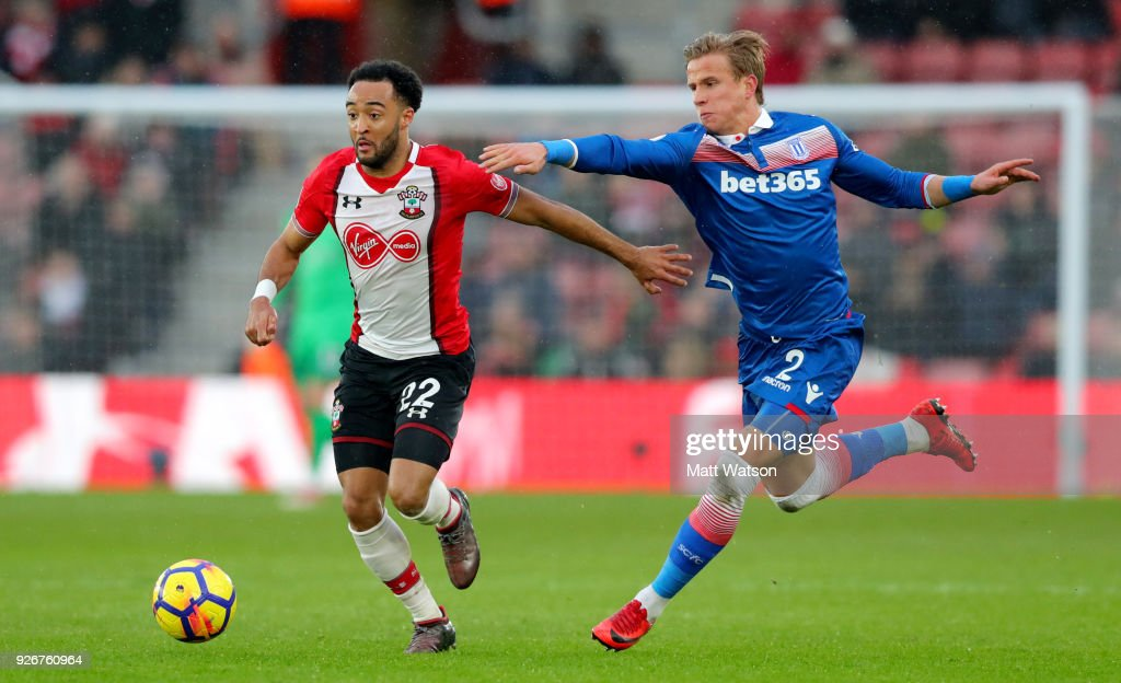 Nathan Redmond (L) of Southampton and Moritz Bauer (R) of Stoke during the Premier League match between Southampton and Stoke City at St Mary's Stadium on March 3, 2018 in Southampton, England.