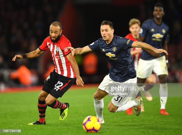 Nathan Redmond of Southampton and Nemanja Matic of Manchester United compete for the ball during the Premier League match between Southampton FC and...