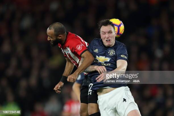 Nathan Redmond of Southampton and Phil Jones of Manchester United go up for a header during the Premier League match between Southampton FC and...