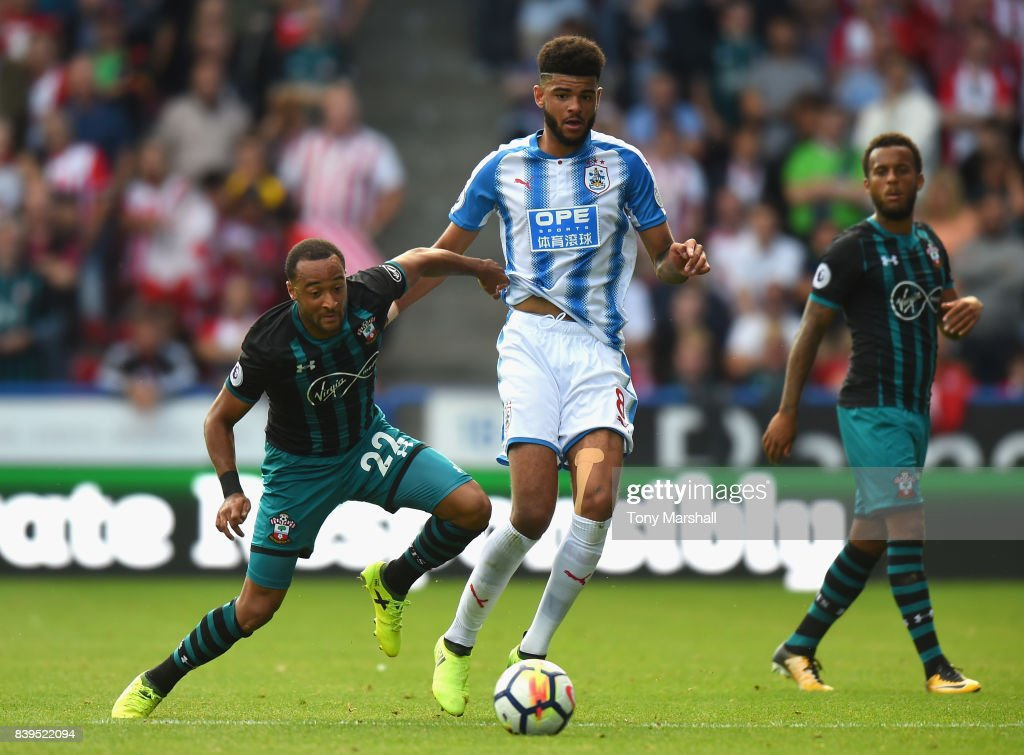 Nathan Redmond of Southampton and Philip Billing of Huddersfield Town battle for possession during the Premier League match between Huddersfield Town and Southampton at John Smith's Stadium on August 26, 2017 in Huddersfield, England.