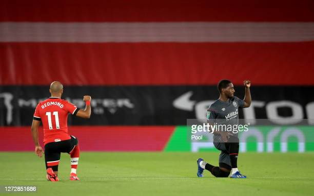 Nathan Redmond of Southampton and Shandon Baptiste of Brentford take the knee in support of the Black Lives Matter Movement prior to the Carabao Cup...