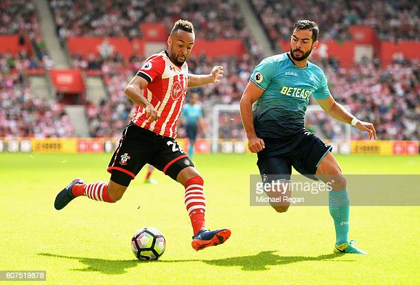 Nathan Redmond of Southampton attmepts a shot while Jordi Amat of Swansea City puts him under pressure during the Premier League match between...