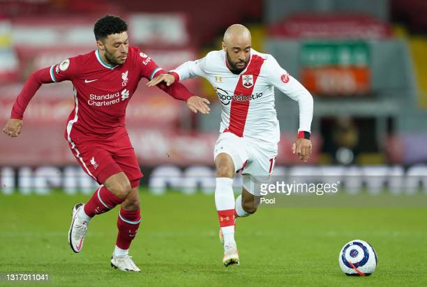 Nathan Redmond of Southampton battles for possession with Alex Oxlade-Chamberlain of Liverpool during the Premier League match between Liverpool and...