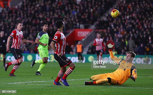 Nathan Redmond of Southampton beats goalkeeper Loris Karius of Liverpool but hits the crossbar during the EFL Cup semifinal first leg match between...