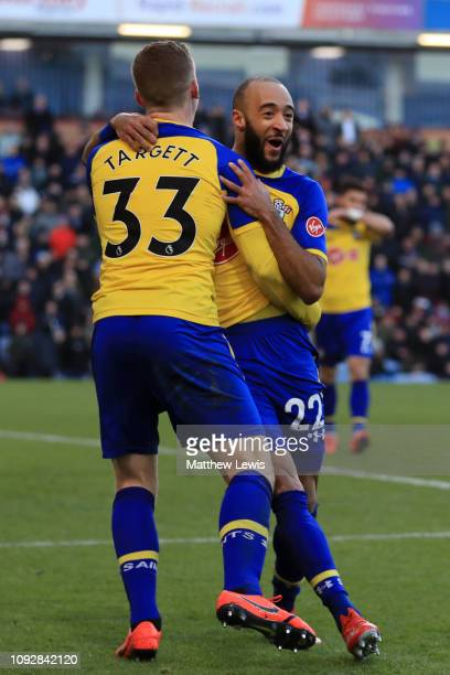 Nathan Redmond of Southampton celebrates after scoring his team's first goal with Matt Targett of Southampton during the Premier League match between...