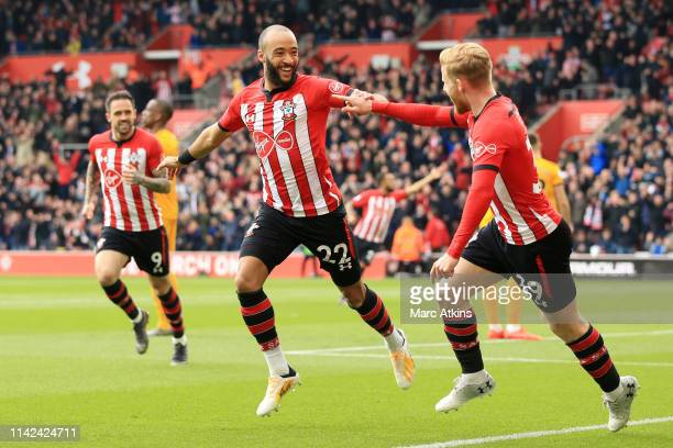 Nathan Redmond of Southampton celebrates after scoring his team's first goal with Josh Sims of Southampton during the Premier League match between...
