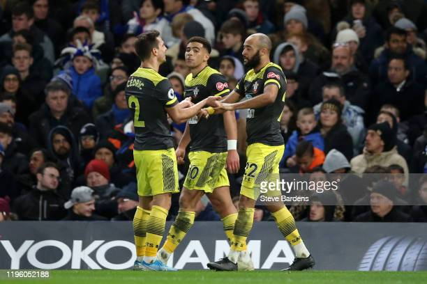 Nathan Redmond of Southampton celebrates after scoring his team's second goal with Cedric Soares and Che Adams of Southampton during the Premier...