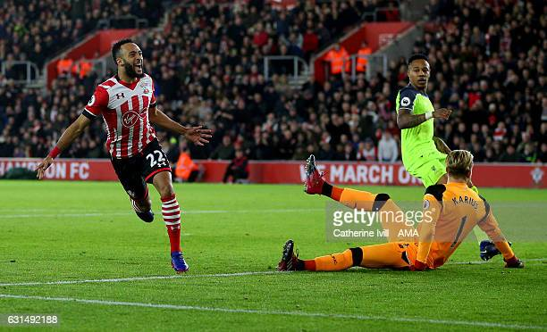 Nathan Redmond of Southampton celebrates past Liverpool goalkeeper Loris Karius after he scores a goal to make it 10 during the EFL Cup semifinal...