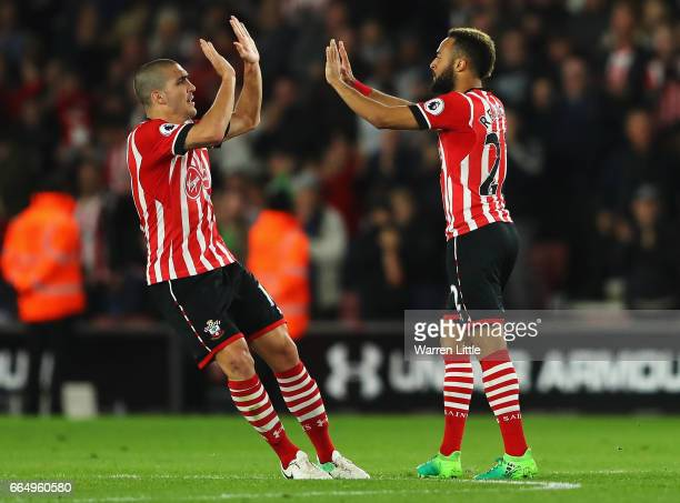 Nathan Redmond of Southampton celebrates scoring his sides second goal with Oriol Romeu of Southampton during the Premier League match between...