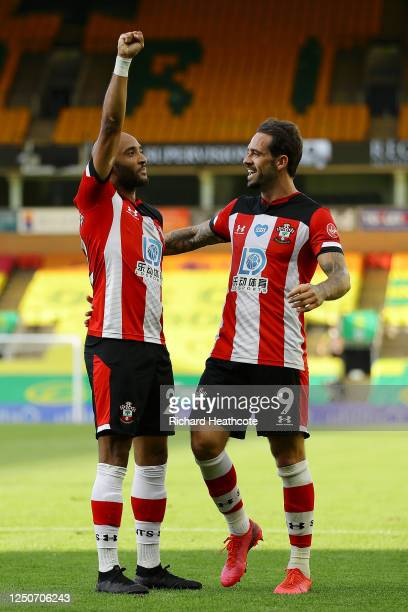 Nathan Redmond of Southampton celebrates with Danny Ings after scoring his team's third goal during the Premier League match between Norwich City and...