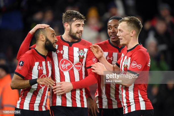 Nathan Redmond of Southampton celebrates with his team after scoring their second goal during the FA Cup Third Round Replay match between Southampton...