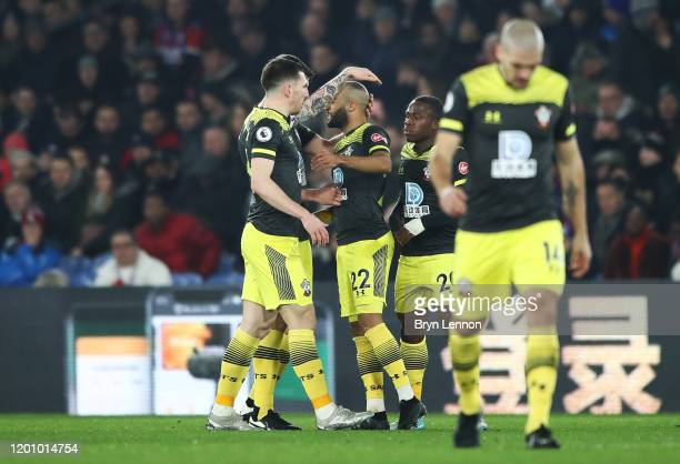 Nathan Redmond of Southampton celebrates with his teammates after scoring his sides first goal during the Premier League match between Crystal Palace...