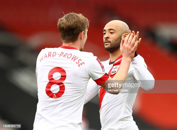 Nathan Redmond of Southampton celebrates with James Ward-Prowse after scoring their team's third goal during The Emirates FA Cup Quarter Final match...