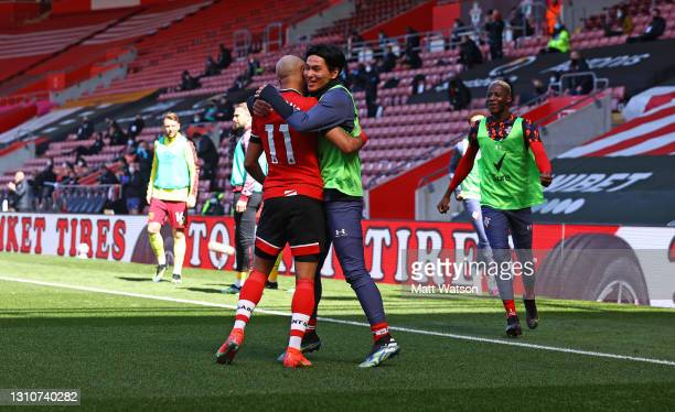 Nathan Redmond of Southampton celebrates with team mate Takumi Minamino during the Premier League match between Southampton and Burnley at St Mary's...