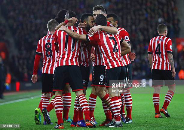 Nathan Redmond of Southampton celebrates with team mates as he scores their first goal during the EFL Cup semifinal first leg match between...